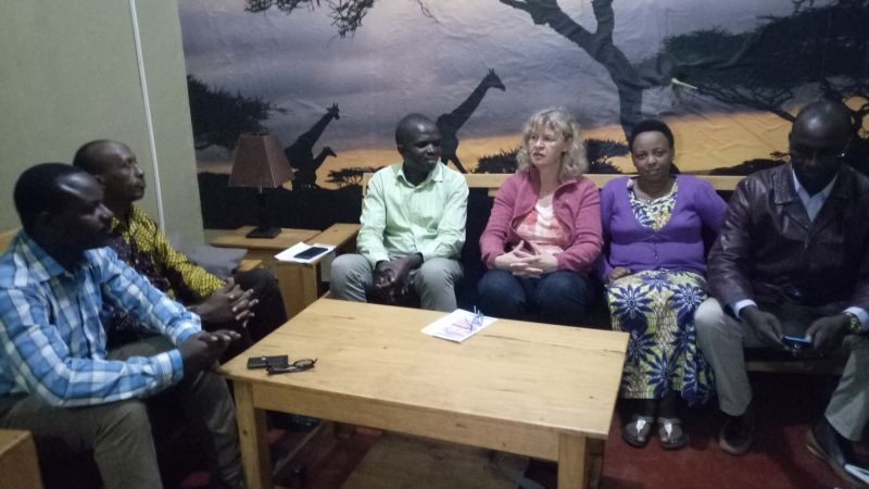 The guest Ms Sabine Schneider discussing with officials from EAR Church Butare diocese