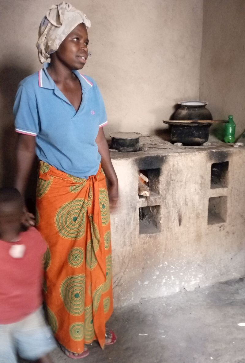 A happy beneficiary of RDIS's Improved Cook Stove
